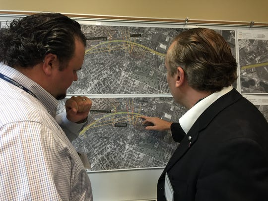 Neil LeBouef, left, of Lafayette Consolidated Government discusses the I-49 Lafayette Connector project with Dr. Olivier Chatelain de Pronville, president of the Sterling Grove Neighborhood Association, March 31, 2016.