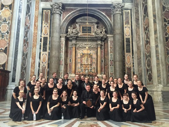 The group of Brighton High School choir students pose prior to singing at a church in Italy.