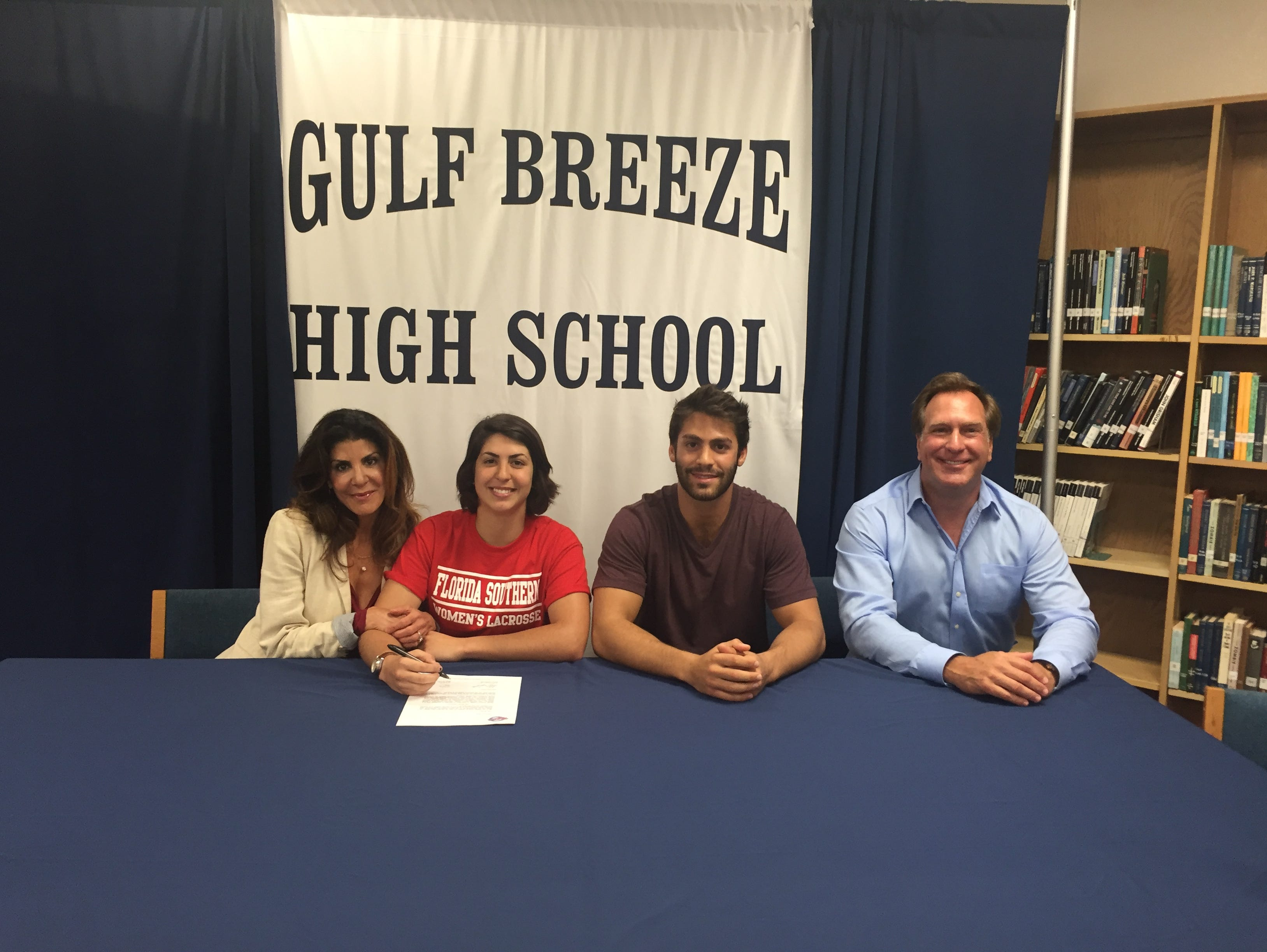 Gulf Breeze High girls lacrosse goalie Alanna Zambetti (center) signs to play at Florida Southern, joined by her mother, Donna, brother Andrew and her father Edward at Thursday's signing event.