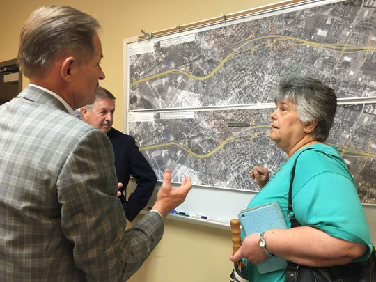 A resident discuss the proposed Interstate 49 Lafayette Connector with consultants, March 31, 2016.