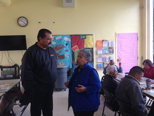 District 1 candidate Tony Barrera talks with a senior citizen at the Firehouse Recreation Center on a recent weekday.