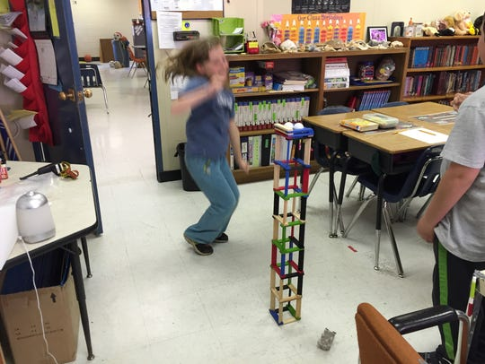 Fourth grader Evelyn Boody jumps for joy after she