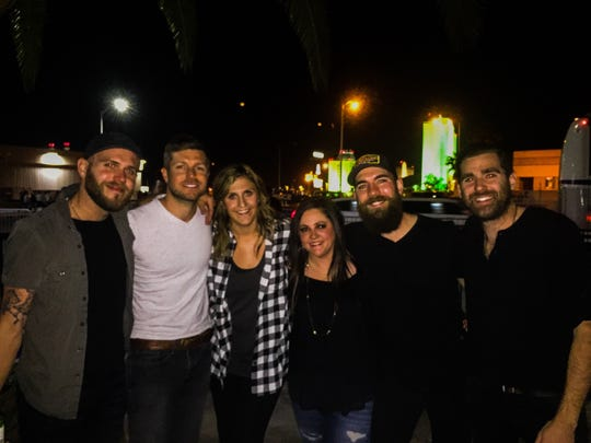Jacob Davis and his band with fans at Brewhouse Music