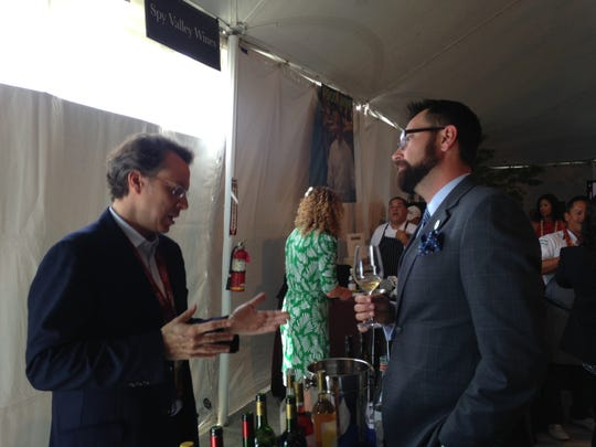 Left, Marc Hochar of Chateau Musar, a winery in Lebanon, talks with an attendee.