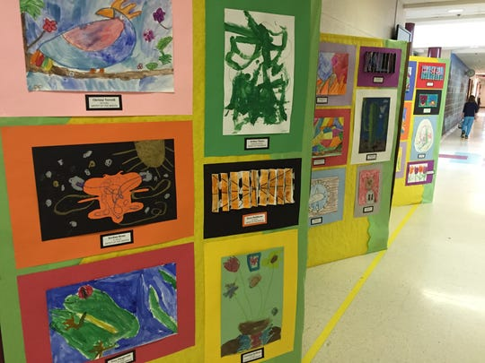 Art students of the month are chosen every month and work is displayed in the hallway outside of the office.