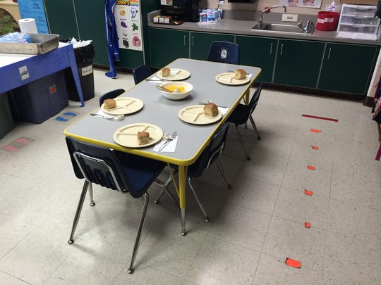 Kindergarten students eat lunch in their classrooms, family-style.