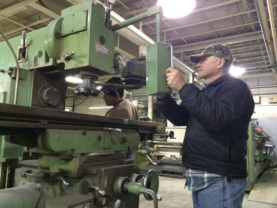 Brian and Jim Birno of Hartford look over a milling