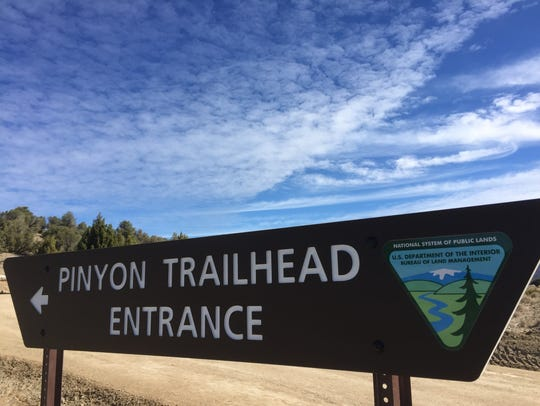 The trailhead to the Pinyon Trail is located on the