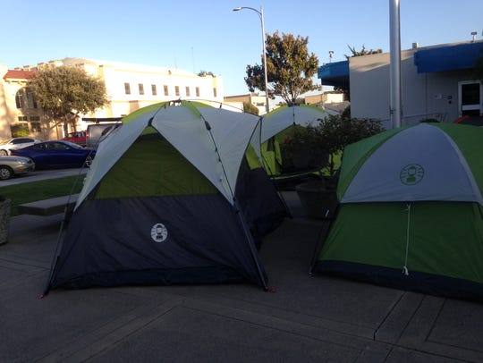 Homeless advocates and homeless set up tents outside
