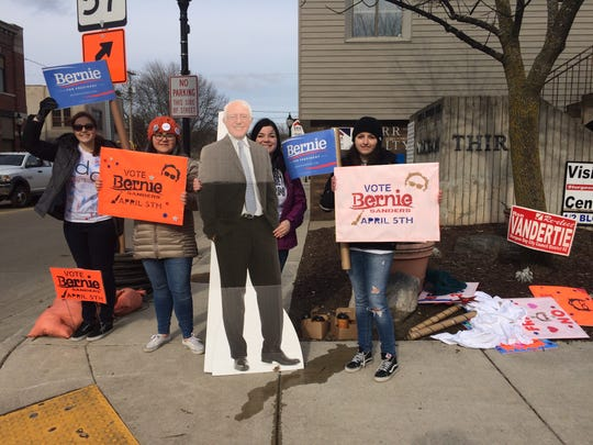 Four Bernie Sanders supporters stood at the busy intersection