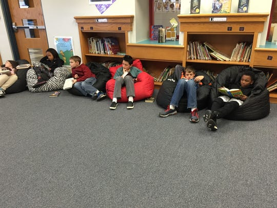 Students read in the library at William Perry Elementary