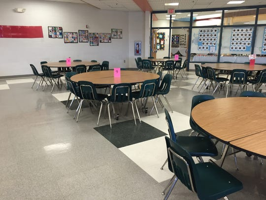 Students eat at smaller tables, family style for breakfast