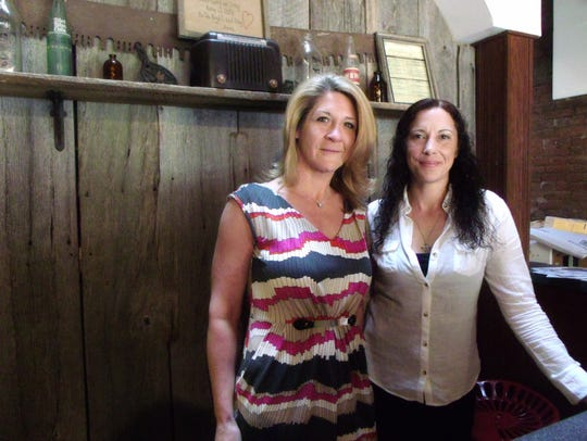 Gina Geiger, left, and Kristen Carpenter were told