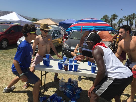 Beer pong action in the campgrounds at the Coachella