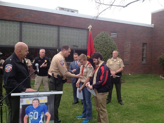 Rutherford County Sheriff Robert Arnold presents Boy