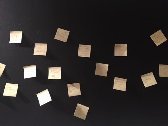 A wall of Post-Its by visitors share stories and encouraging