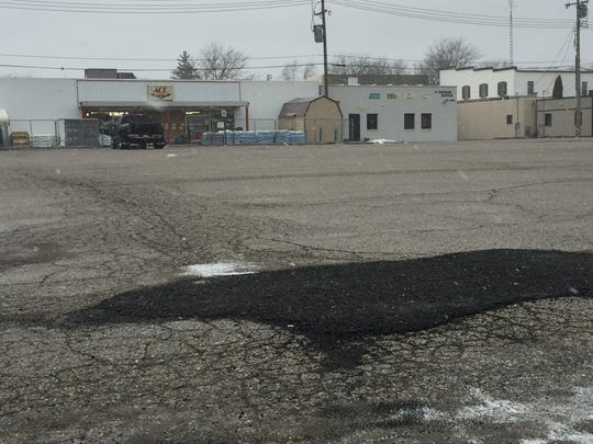 The city will reconstruct a parking lot behind Ace