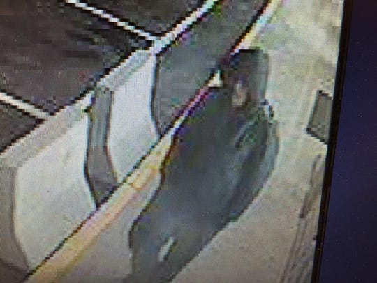 This surveillance photo shows the robbery suspect outside