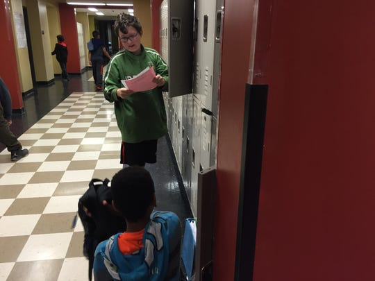 Each grade level at Kate Collins Middle is like a school within a school. Here sixth graders go to their lockers between classes in the designated sixth grade hallway.