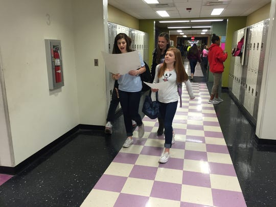 Each grade level at Kate Collins Middle School operates like a school within a school. Here eighth grade students walk down their hallway between classes.