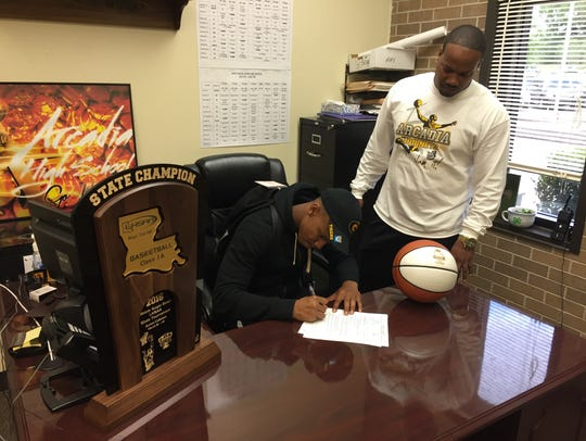Arcadia's Travious Fielding signs a scholarship with
