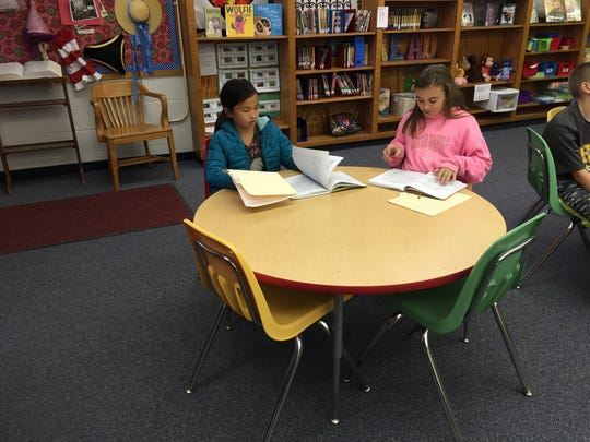 Students in the Young Author's club wait for the start of their monthly meeting in the library on Wednesday.
