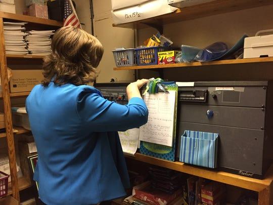 Principal Tina Bowersox reads the morning announcements