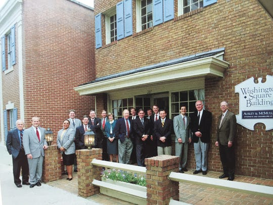 Members of the Ausley and McMullen law firm in front of the old Ausley and McMullen building in 2001.