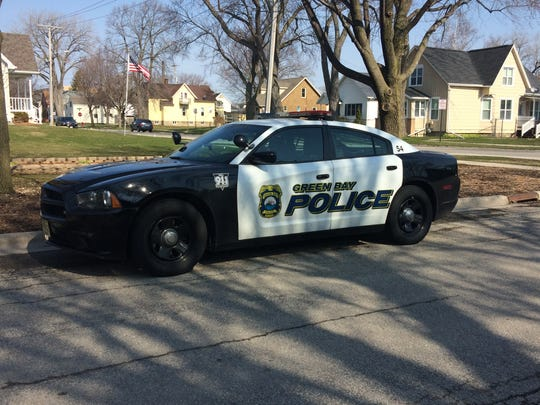 A Green Bay Police car parked on Day Street as officers walk neighborhoods and speak with residents about concerns of community.