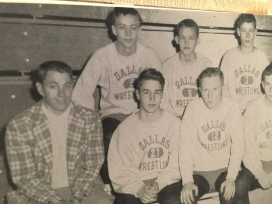 Denys Overholser, front row second from left, participated in wrestling at Dallas High School, where he graduated in 1956.