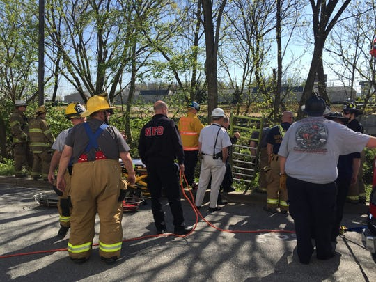 Emergency crews attempting to rescue man who fell in New Castle area ditch Friday.