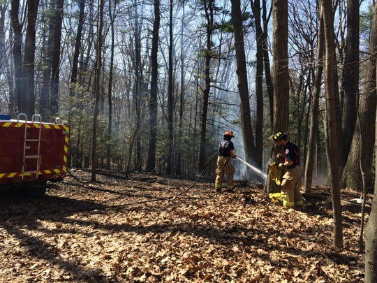 Firefighters in South Burlington at the scene of a brush fire off Spear Street.