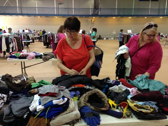 Regina Michelle and Gwen Smith shop at a rummage sale