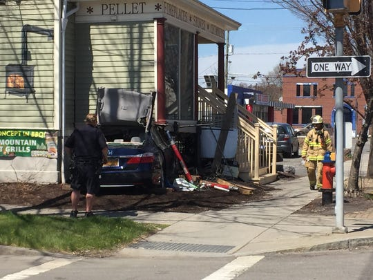 The blue Honda Accord's entire front-end was lodged under the building's porch when emergency responders used the the jaws of life to peel open the vehicle's roof.