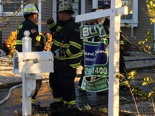 A for sale sign in front of the home that burned in Point Pleasant early Monday.