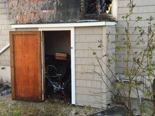 A shed attached to the side of a house that burned in Point Pleasant Monday was completely untouched by the fire.