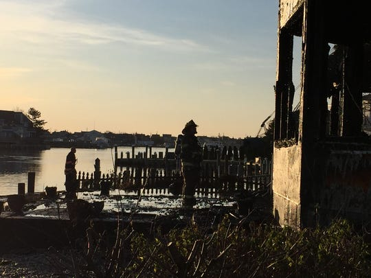 A firefighter looks at damage to the back of a Point