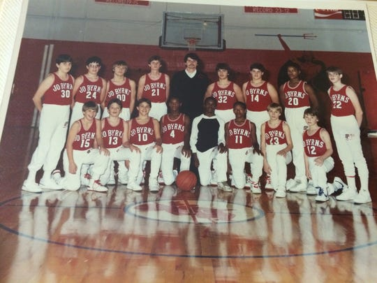 Coach Kenneth Holman poses with the Jo Byrns School basketball team early in his career.