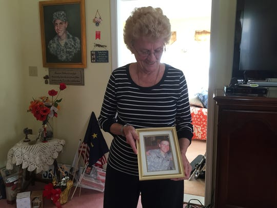 Trudy Corma shows a photo of her son, Sal, at her Deptford home. He was killed in Afghanistan in 2010.