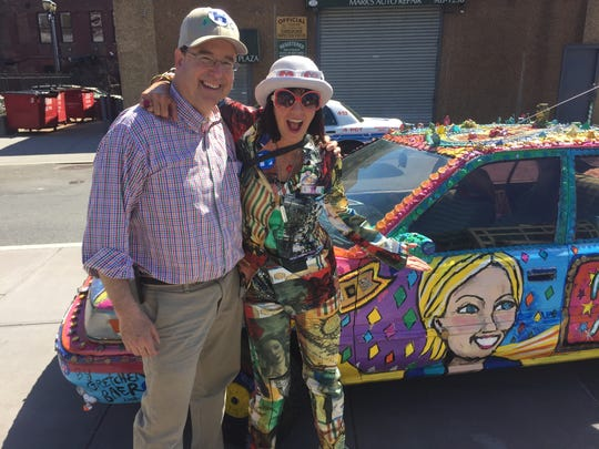 """Former Yonkers City Council President Chuck Lesnick yuks it up with Gretchen Baer, creator of the """"Hill Car"""""""