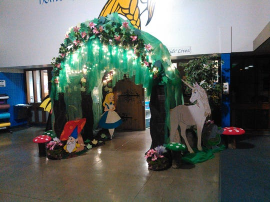 """Organizer Tammy Baxter and her helpers injected a bit of enthusiasm into the decorations as a """"Scholastic Enchanted Forest"""" theme illustrates Stayton Intermediate/Middle School's twice-annual book fair this week."""
