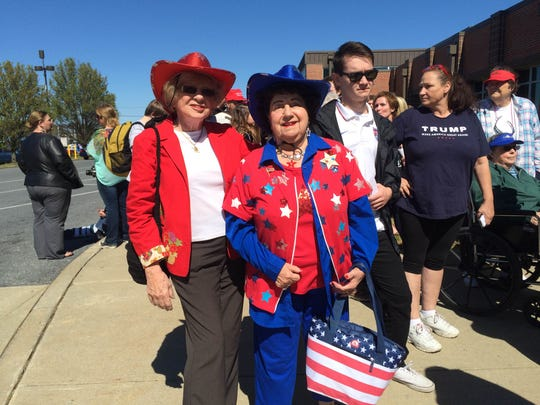 Lee Tilghman, left, and Anna Foultz wait toward the front of the line to see Donald Trump at Stephen Decatur High School in Berlin, Maryland April 20, 2016.