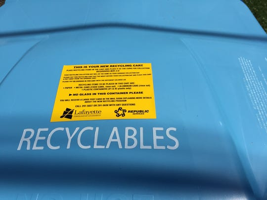 Labels on top of new recycling bins for city of Lafayette
