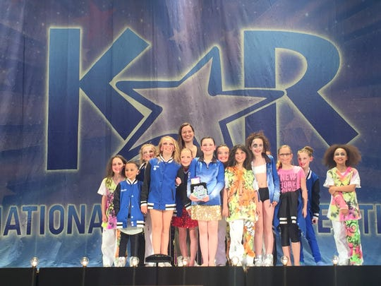 Team director Jennifer Russo with a group of dancers