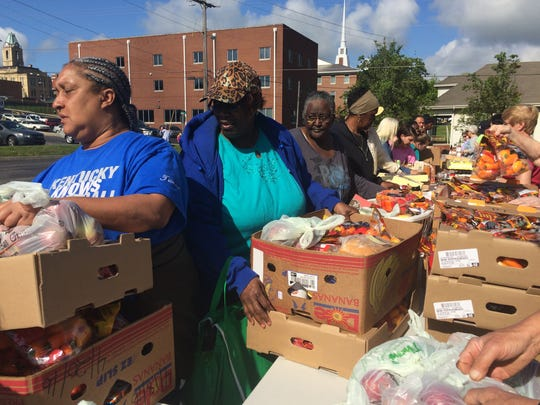 On Willow Street, behind the Springfield Baptist Church on Friday, people lined up and collected free food distributed by the United Ministries.