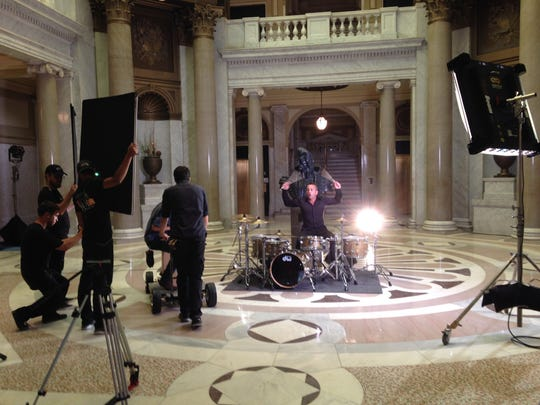"""Newsboys drummer Duncan Phillips performs during filming for the Christian movie """"God's Not Dead 2."""""""