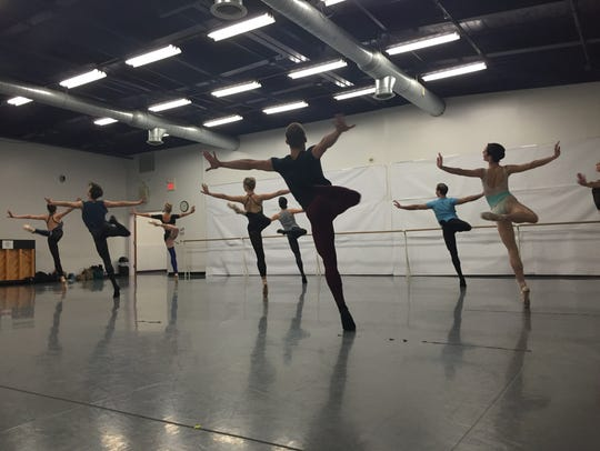 The company dancers soar and move in unison during