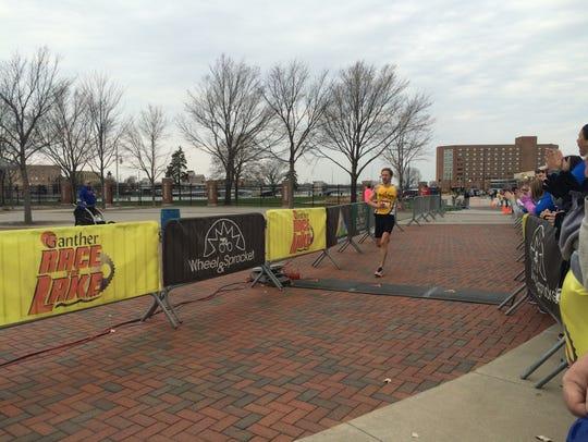 Jason Ryf of Oshkosh wins the half marathon.