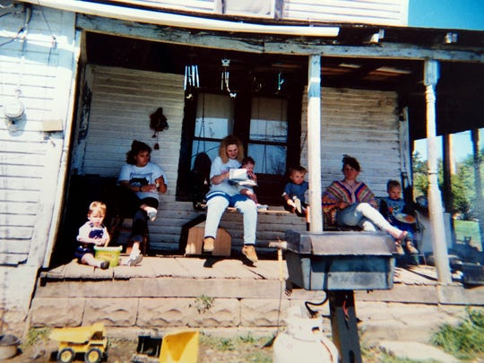 Family photo (Dana Rhoden second from left) in front of a family home, neighboring their own, in Pike County, Ohio, as seen on Monday, April 25, 2016.