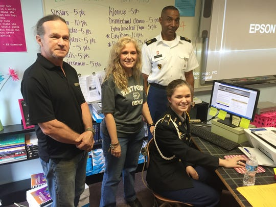 Alyssa Milner, a senior at Natchitoches Central High School, accepts her appointment to the United States Military Academy at West Point. With her are 1st. Sgt. Michael Selby, her JROTC leader, and parents Mark and Monique Milner.